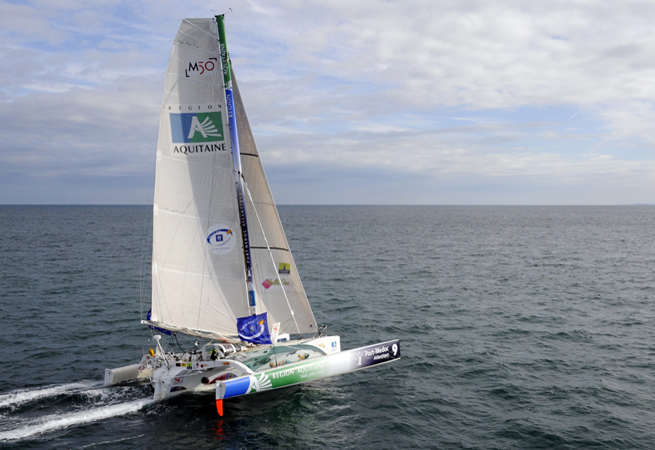 "French skipper Lalou Roucayrol sails on his ""Region Aquitaine Port Medoc"" multihull on October 21, 2010 off the coast of Saint Malo, western France in preparation for the 9th Route du Rhum sailing race to start on October 31, 2010. The ""Route du Rhum - Banque Postale"" is a solo race held every four years between Saint-Malo to Pointe-à-Pitre in the French West Indies. AFP PHOTO DAMIEN MEYER"